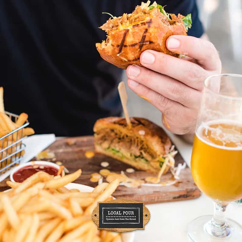 Customer enjoying a burger and fries
