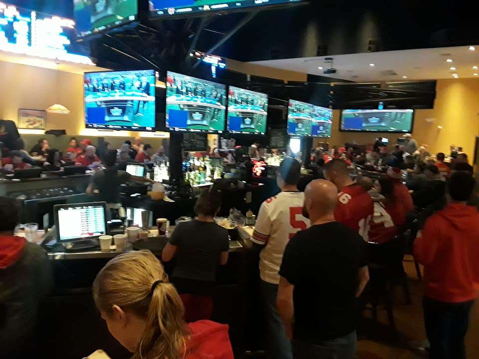 Multiple big screen TVs for sports and entertainment