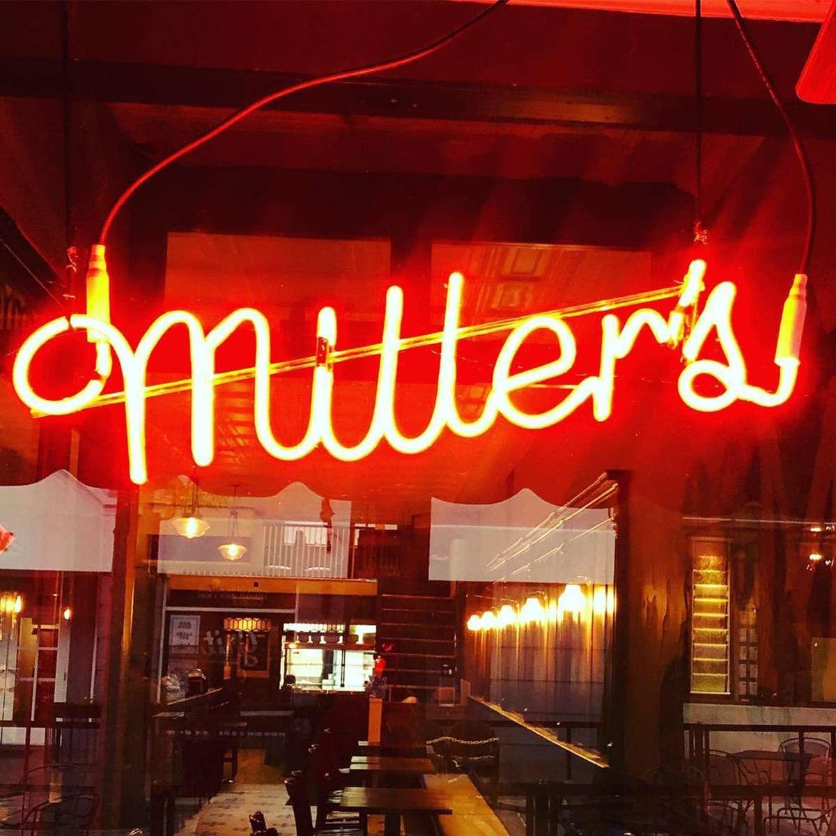 Miller's red neon sign in window