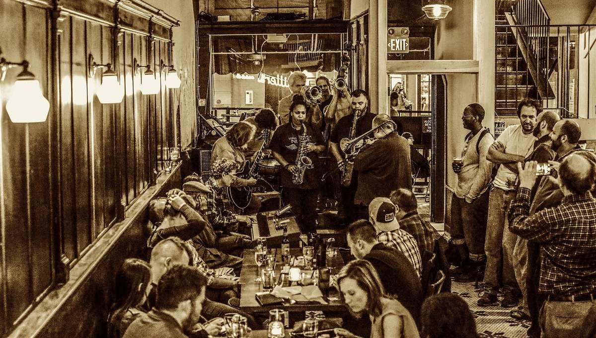 Sepia toned image of a crowded bar