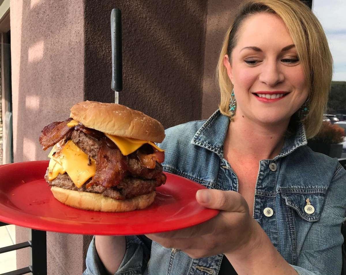 girl and large hamburger