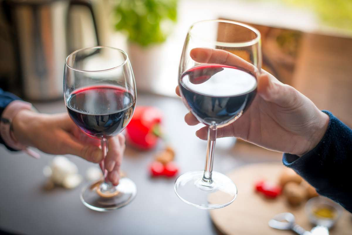 two people with wine glasses