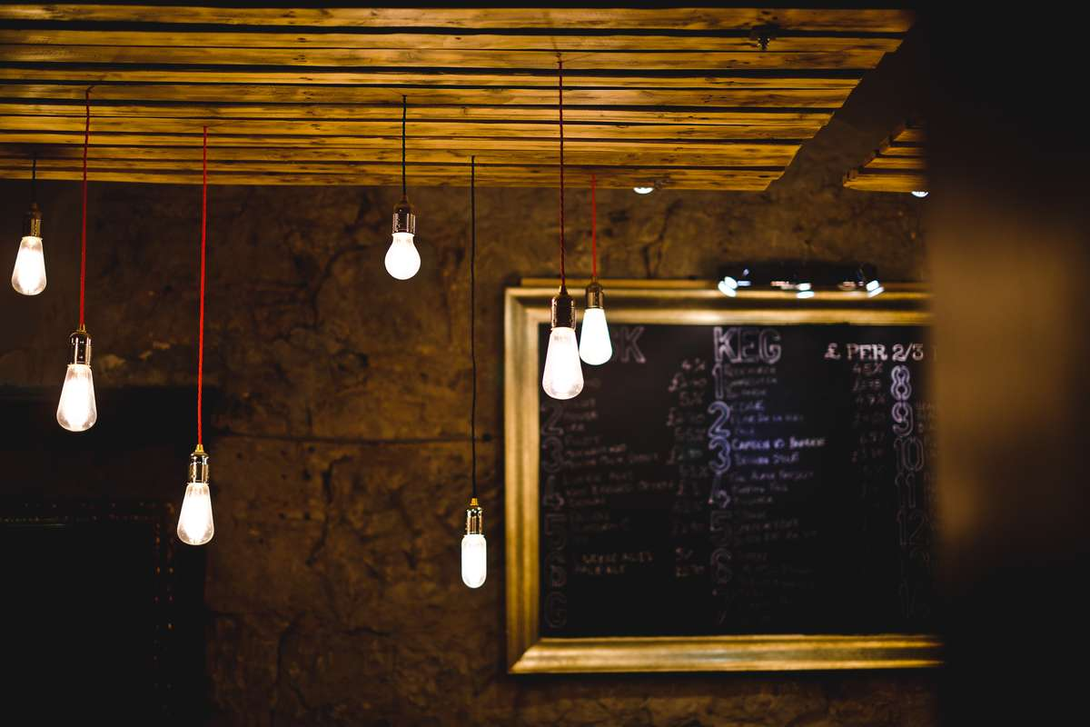 Long string lights hanging from wood ceiling
