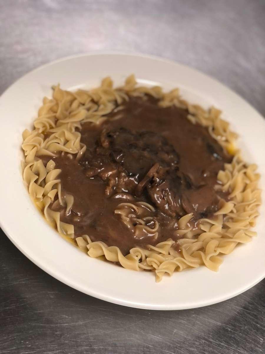 Salisbury Steak over egg noodles