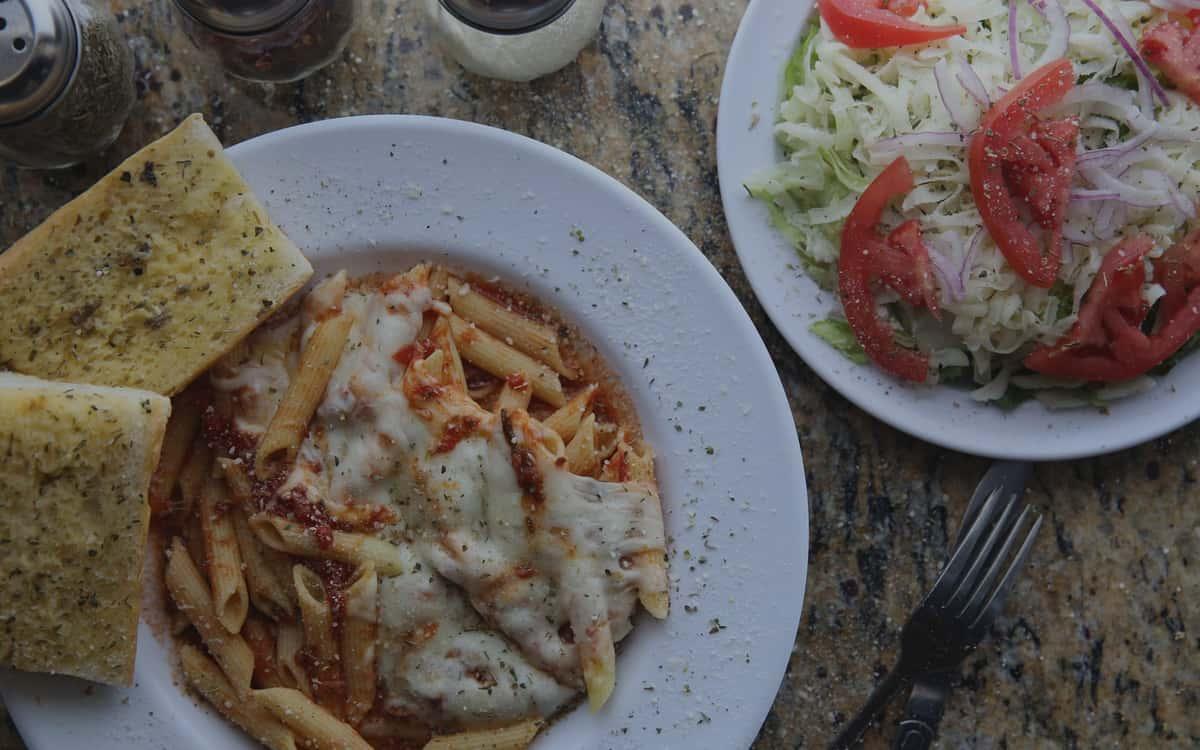 ziti with salad and garlic bread