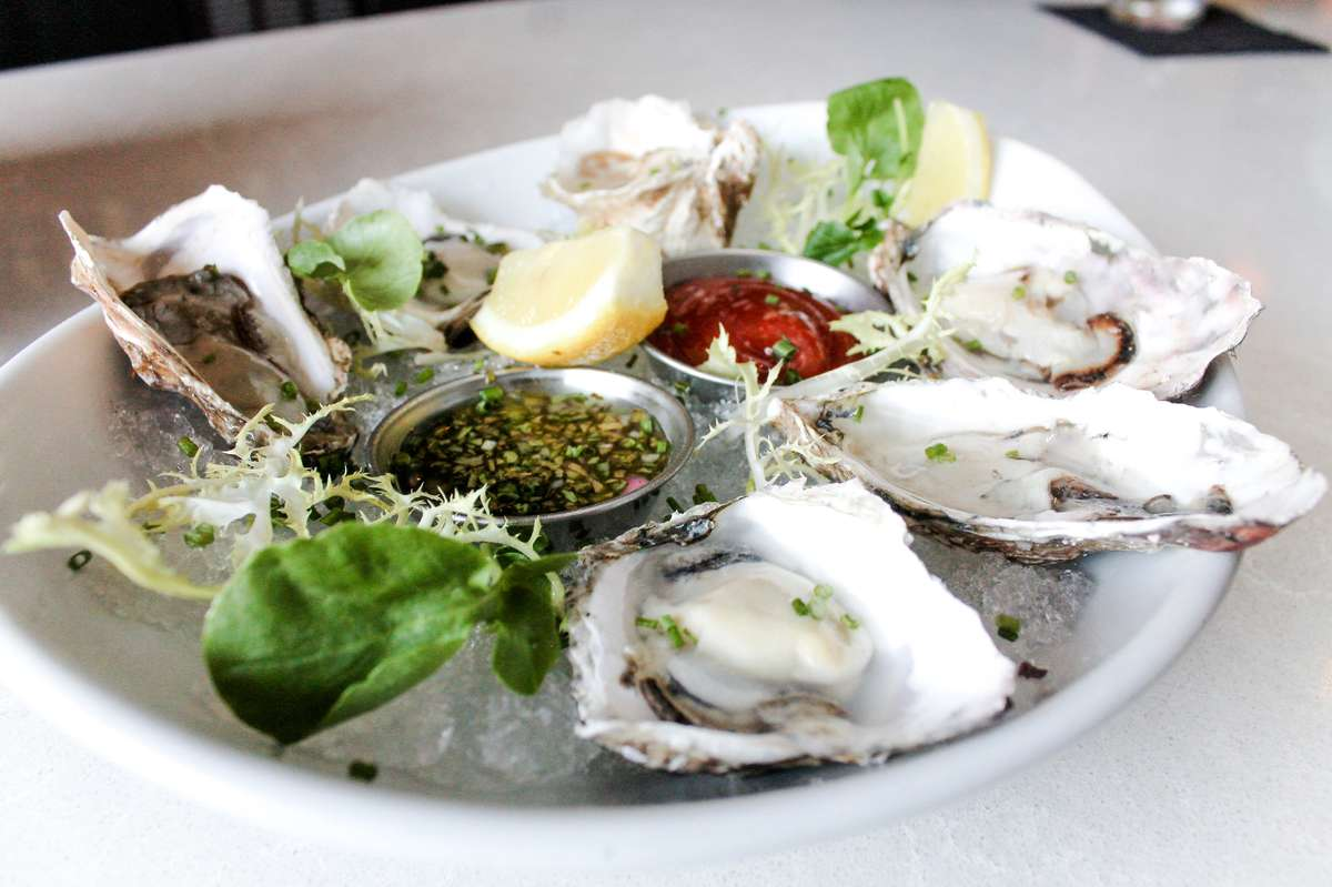 Market Fresh Oysters on the Half Shell with sauces in the middle