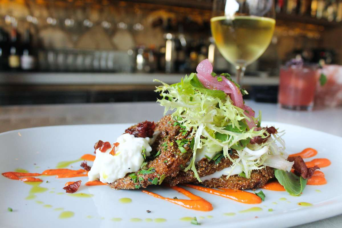 Fried Green Tomatoes with Fresh Burrata on a white plate