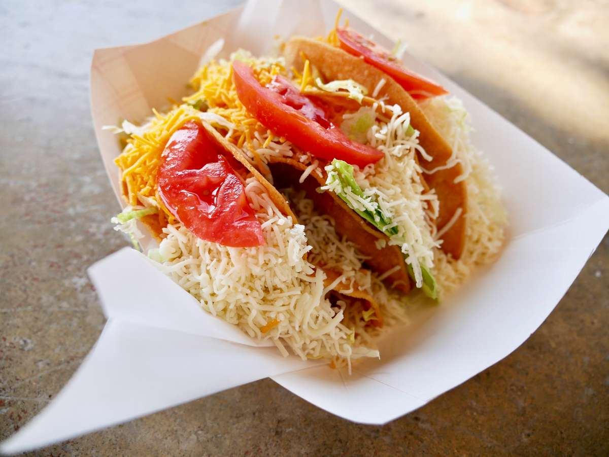 two hard tacos with cheese