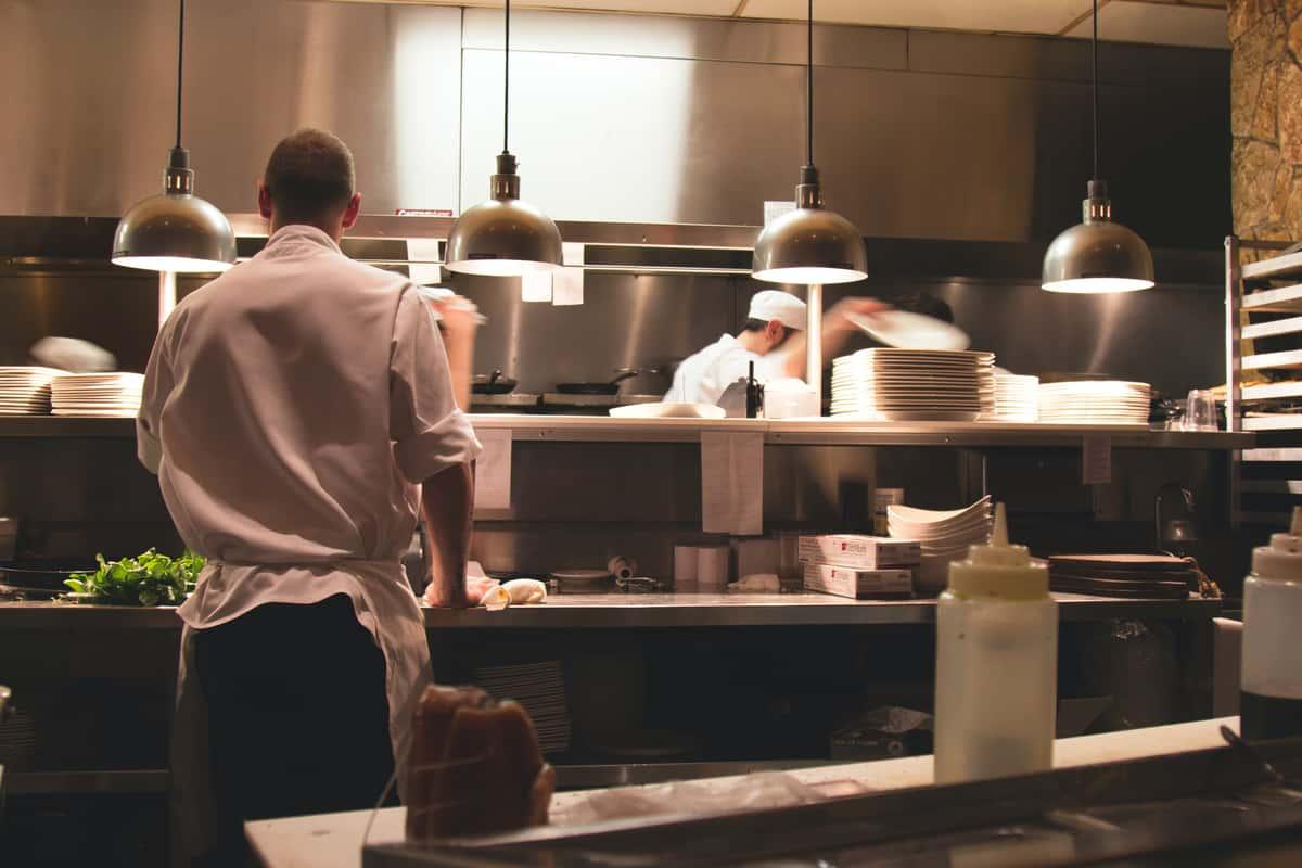 Staff cooking in a restaurant kitchen