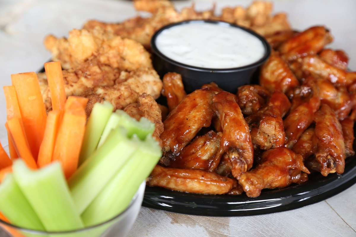 catering wing platter with celery and carrots