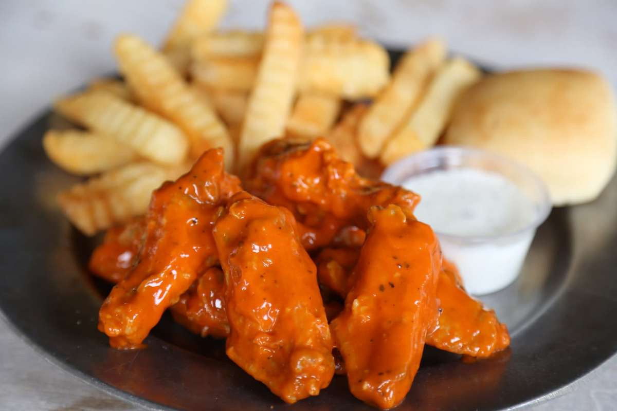 chicken wings, fries, ranch, and yeast roll