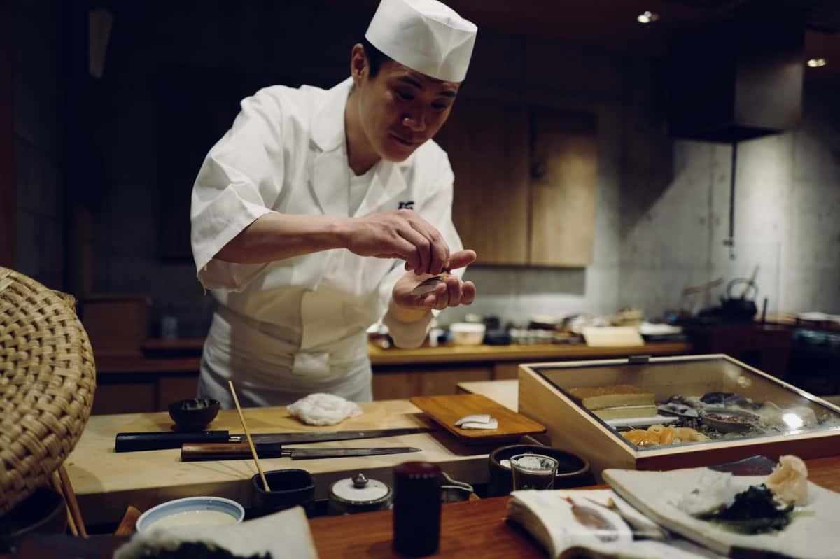 Sushi chef preparing sushi