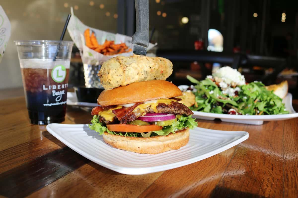 burger, salad, onion rings, soda