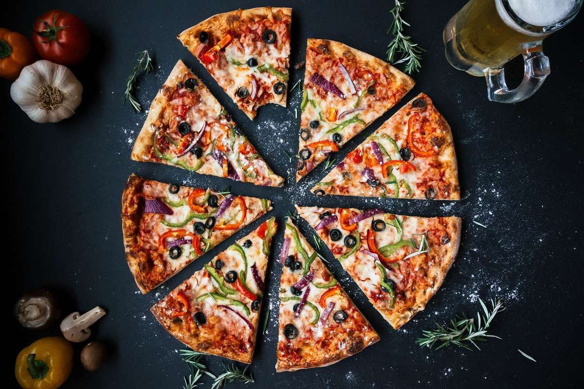 Pizza with black olives, green and red peppers, and onion