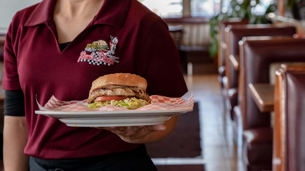 worker holding turkey burger