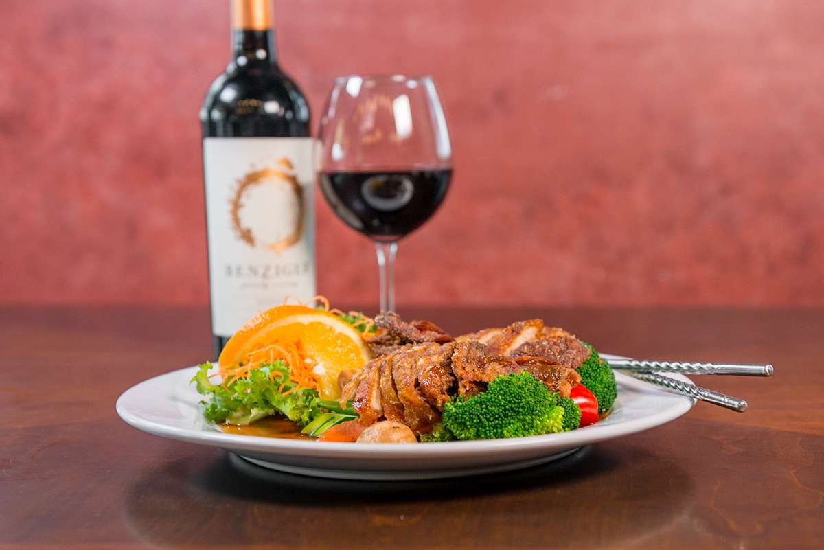 Meat, vegetables, and red wine