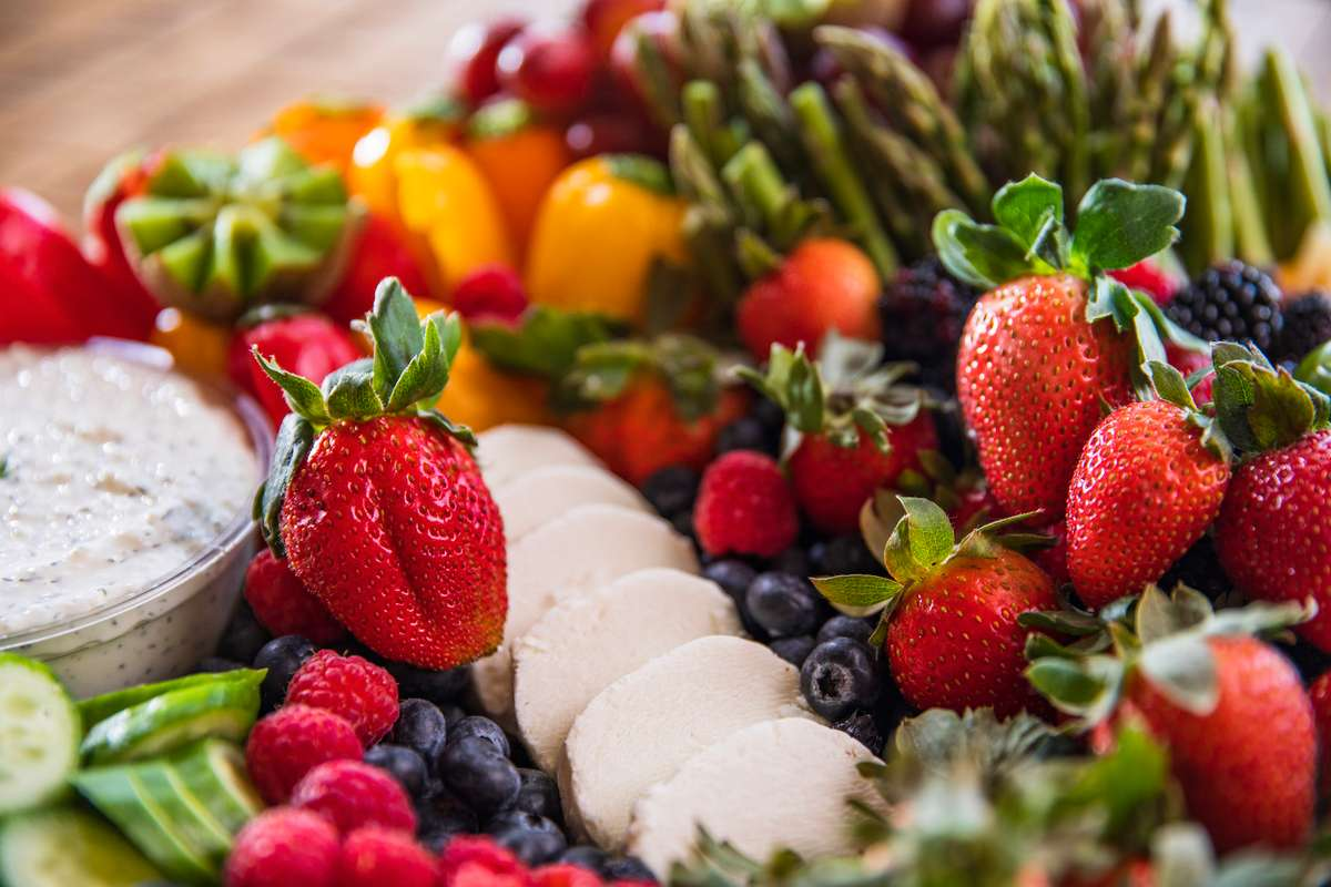 Various fruits, vegetables and dips
