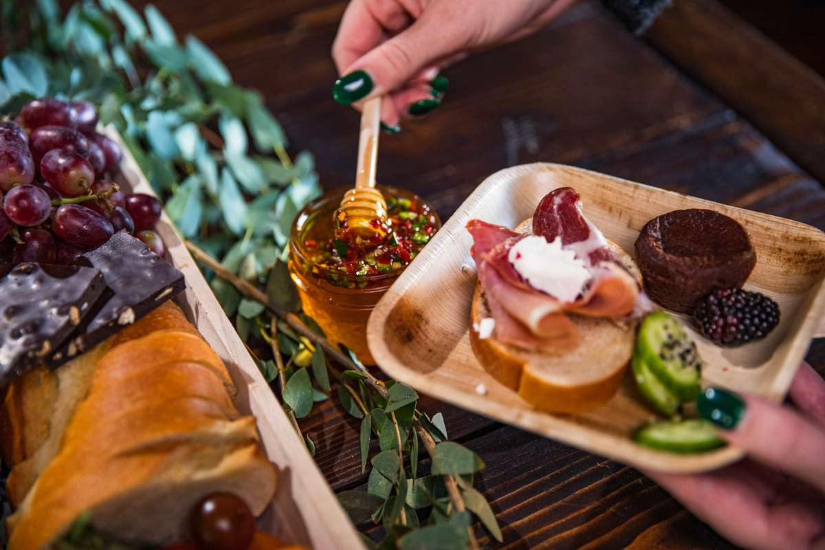 Guest serving themself from a charcuterie board
