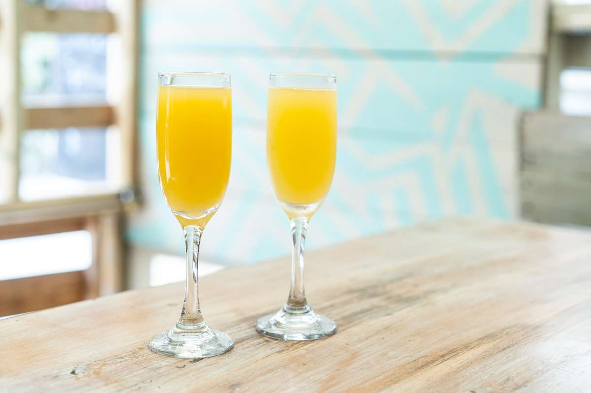 Mimosas in fluted glass