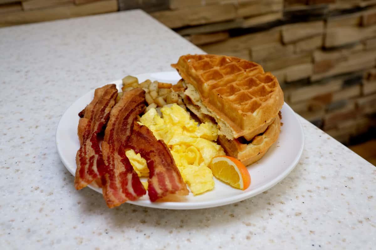 Waffles, Bacon, Eggs, and potatoes