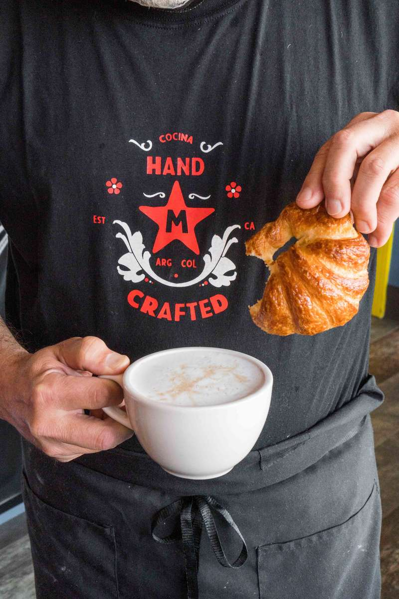Holding coffee and pastry