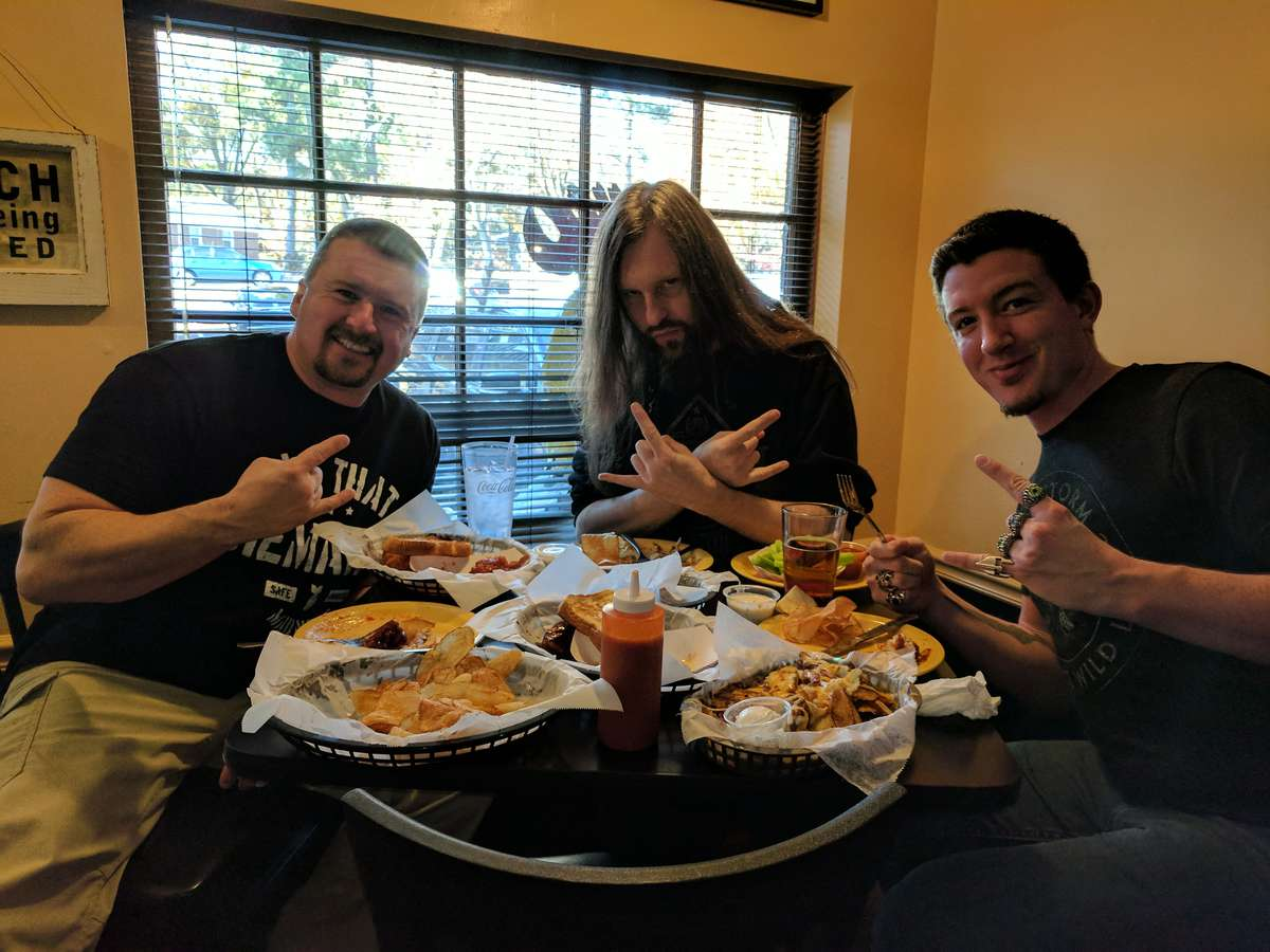 group of guys at table of food
