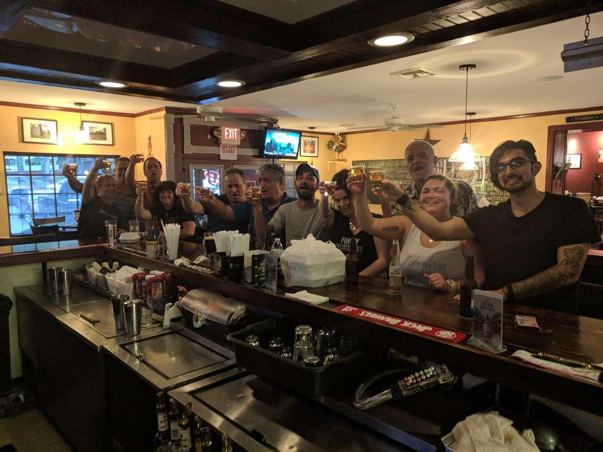 group cheers-ing at bar