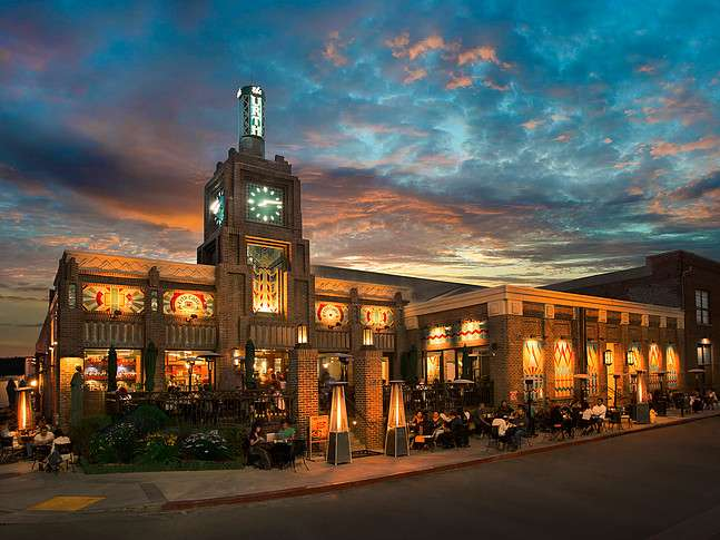 Exterior of Urth Caffe Downtown Los Angeles with sunset and clouds behind it