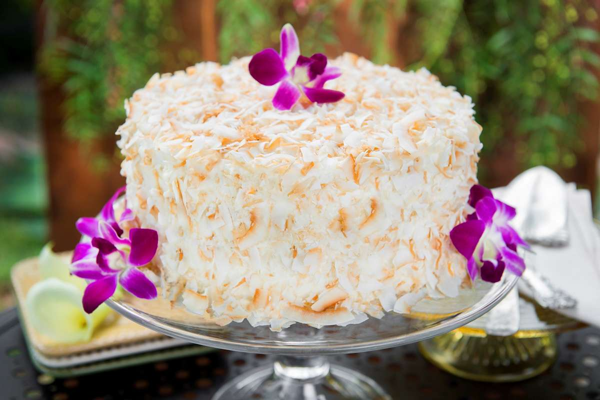 White cake with toasted coconut on it