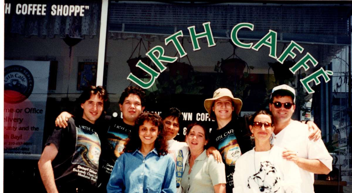 8 people stand in front of Urth Caffe Manhattan Beach