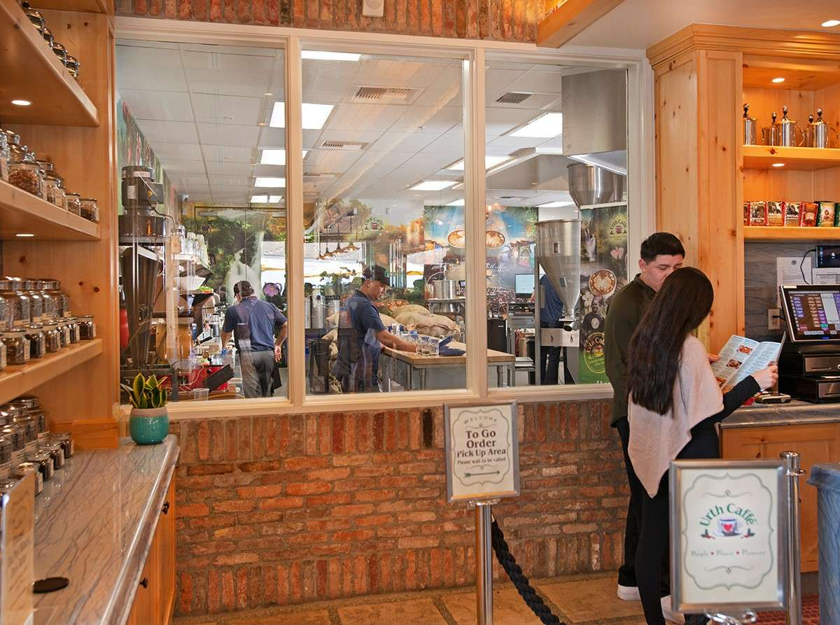 Lobby window at Urth South Bay allows guests to look inside coffee roasting department
