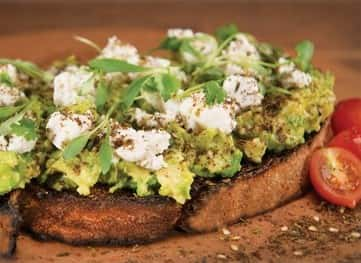 Avocado on toast with cheese on top