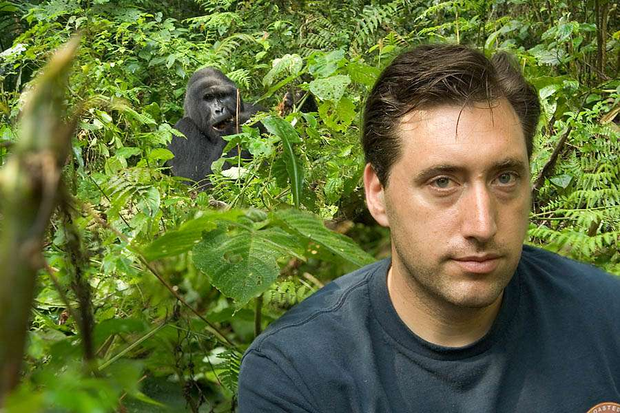 Urth Caffe co founder Shallom Berkman in foreground, gorilla in background, in jungle