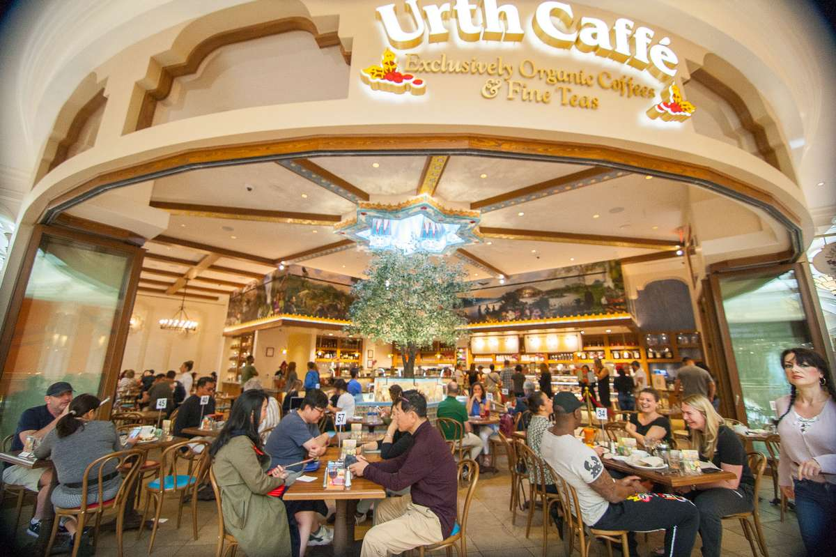 Exterior view of Urth Caffe at the Wynn in Las Vegas showing guests at table along walkway