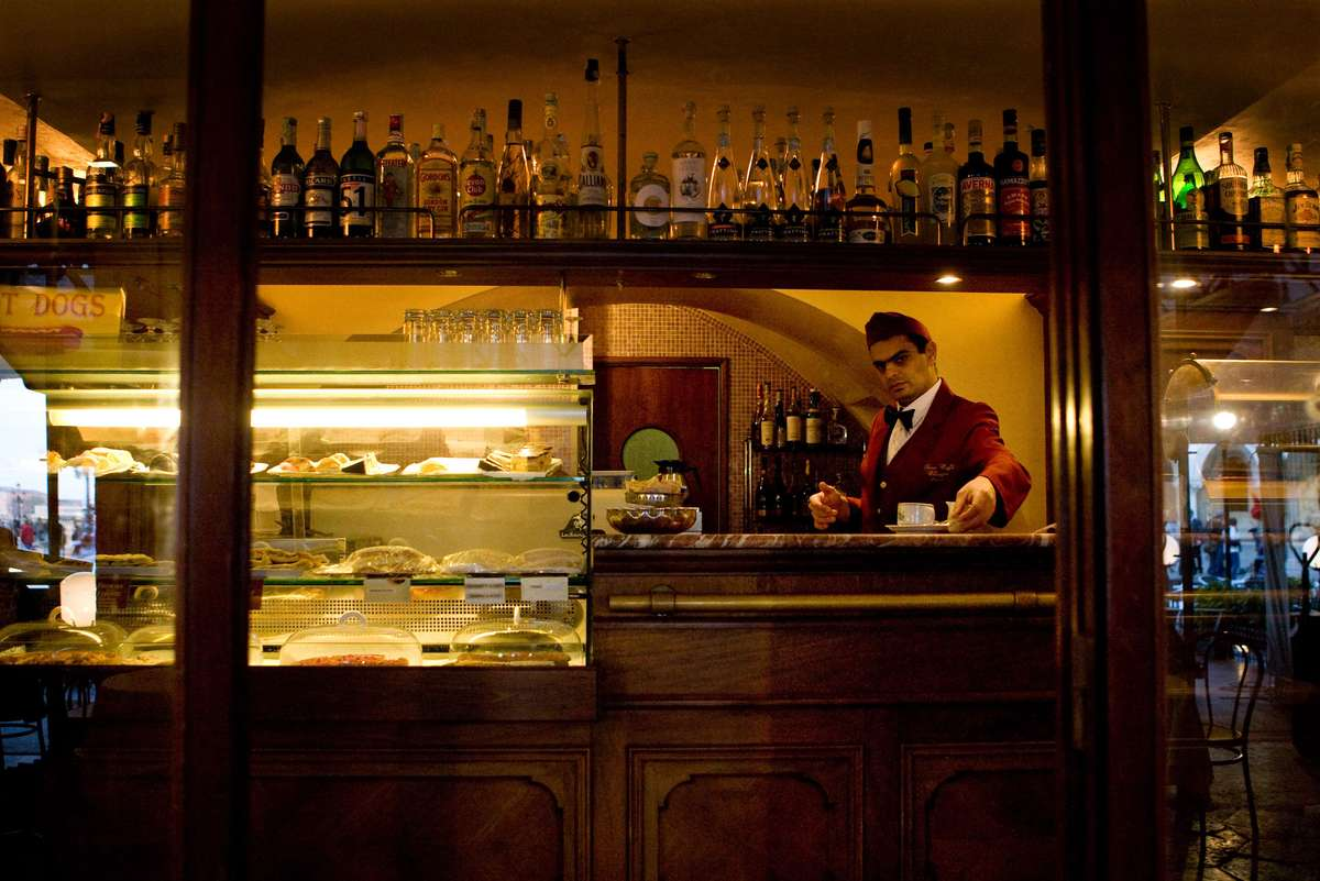 Waiter is viewed behind the counter at a cafe in Venice Italy