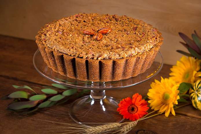 Whole Sweet Potato Pie with graham cracker crust, pecan topping and three whole pecans