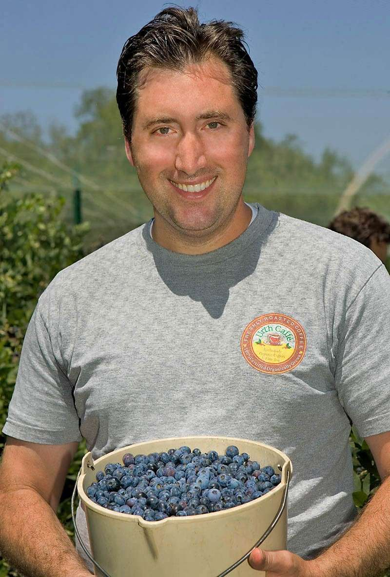Urth Caff´c0-founder Shallom Berkman holds a bucket of blueberries