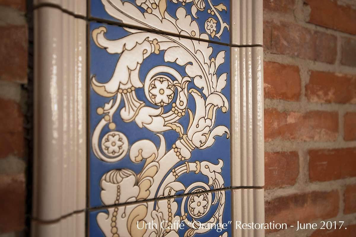 close up of blue and white floral tile