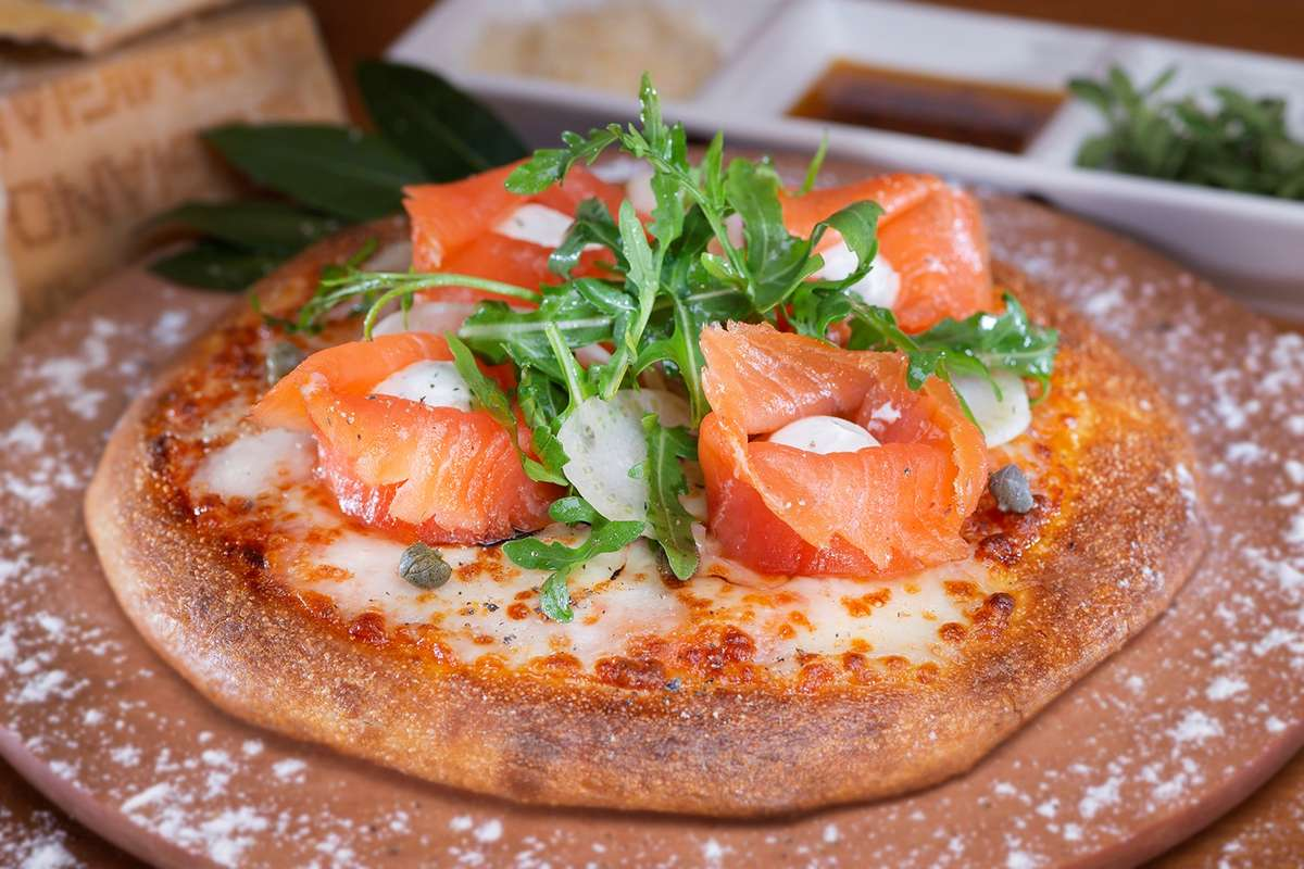 Middle photo - D'Lox Pizza topped with lox.