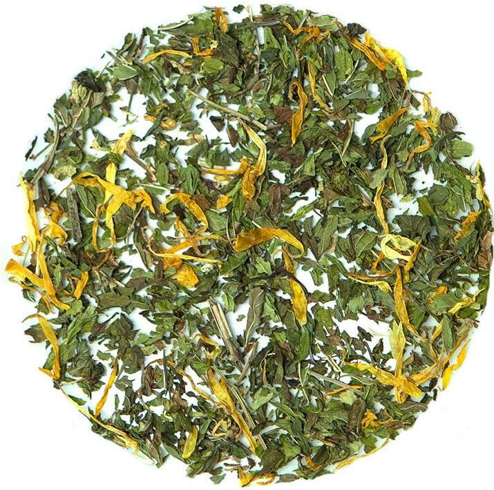 Loose leaf tea green leaves and yellow flower petals