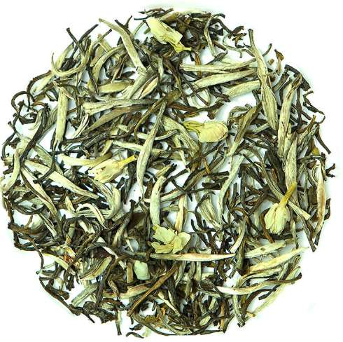Loose leaf teas with jasmine flowers and green leaves