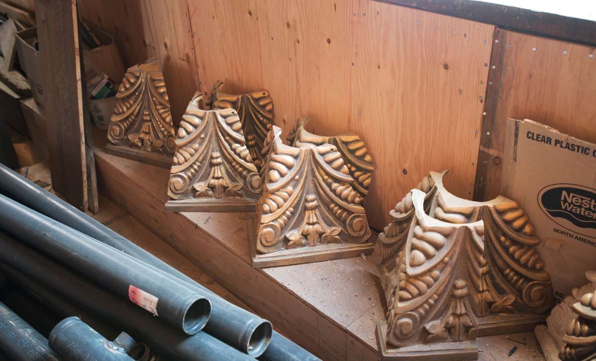 Molds were sculpted to duplicate missing column capitals,