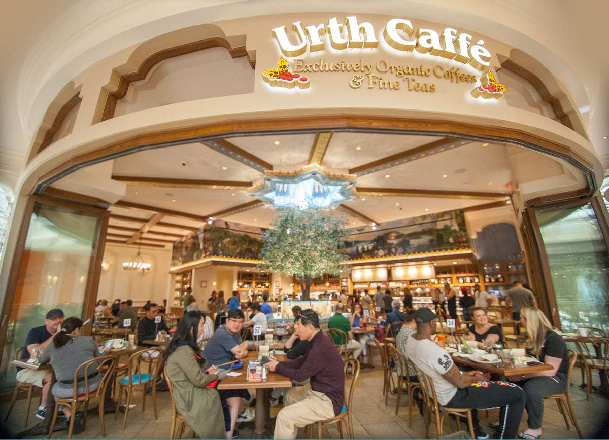 Urth Caffe at the Wynn Plaza Las Vegas - view from front showing guests dining on the walkway out front and into the cafe