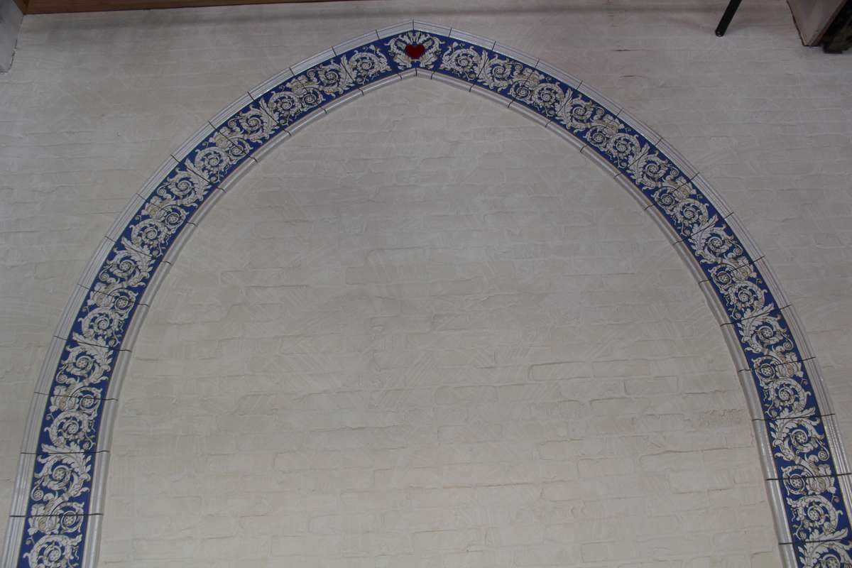 Blue and white tile arch on a white wall