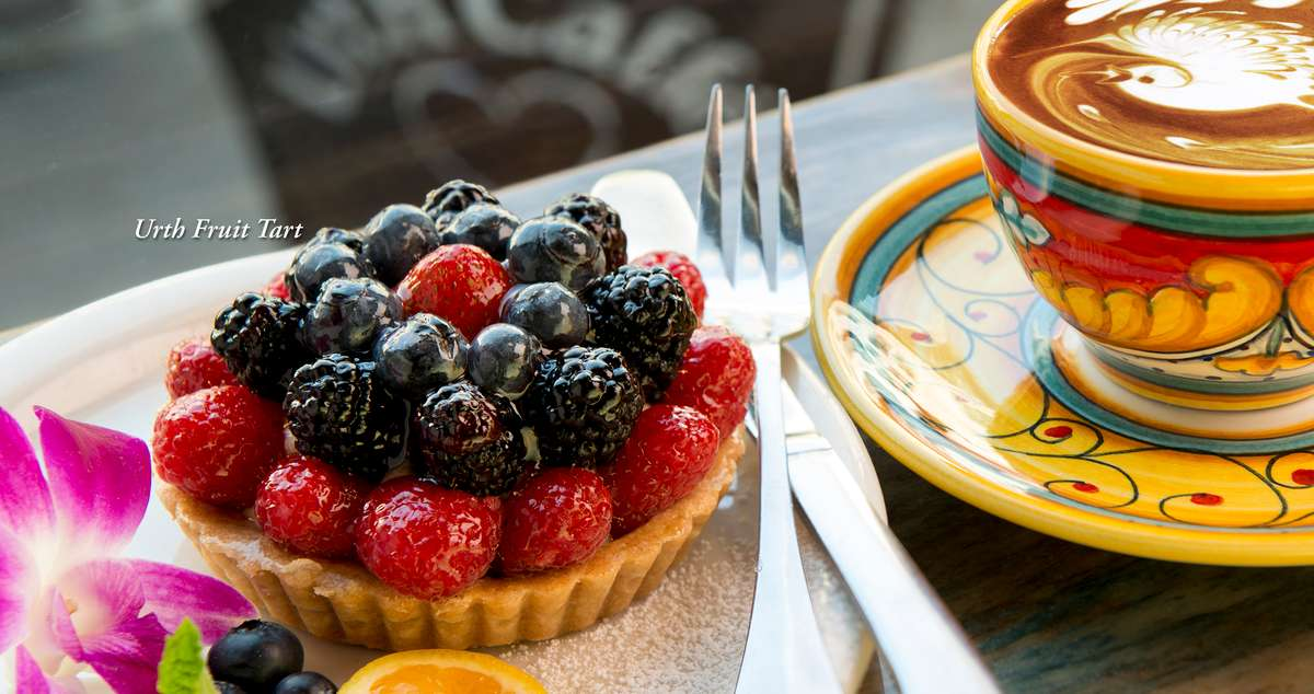 Urth Fruit tart with decorative cup of Mocha latte nearb