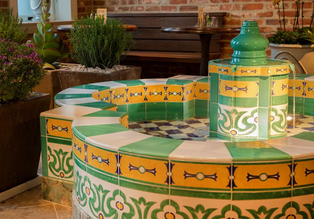 Finished fountain with its decorative green and gold tile designs