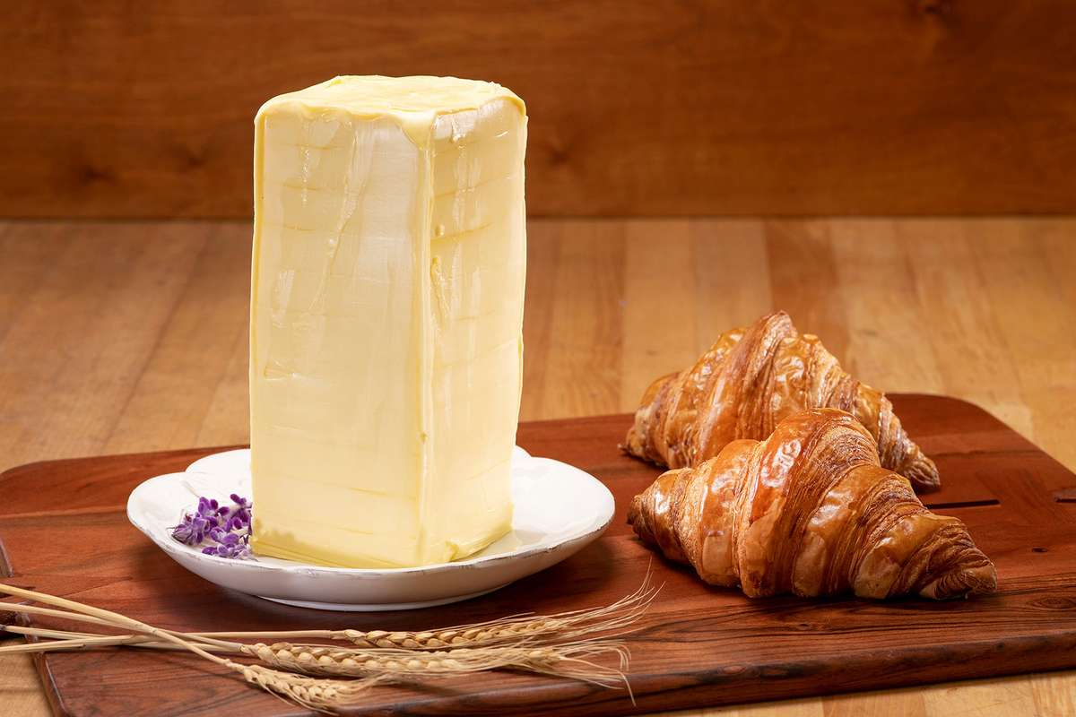 Large block of butter and two croissants