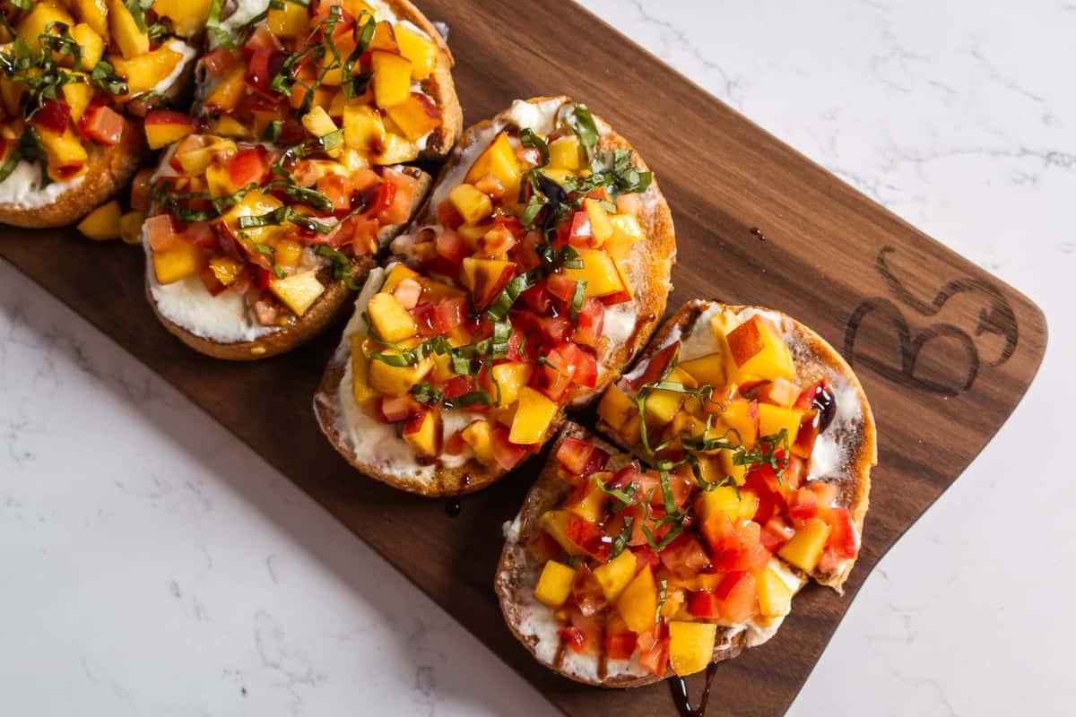 Seasonal: Peaches, diced tomatoes, passionfruit-infused mascarpone, fresh basil, balsamic reduction