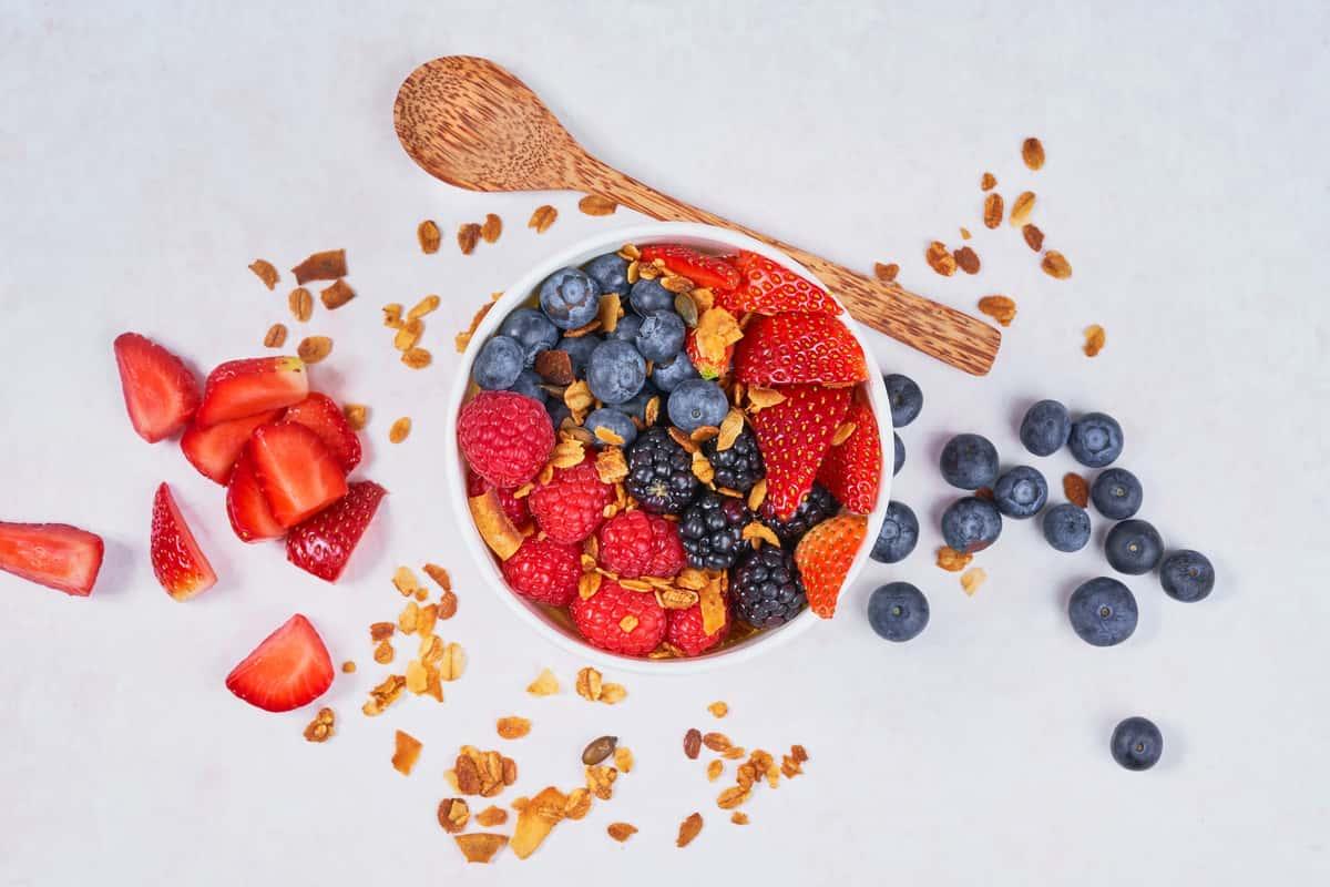 Fresh fruit bowl with strawberries, raspberries and blue berries