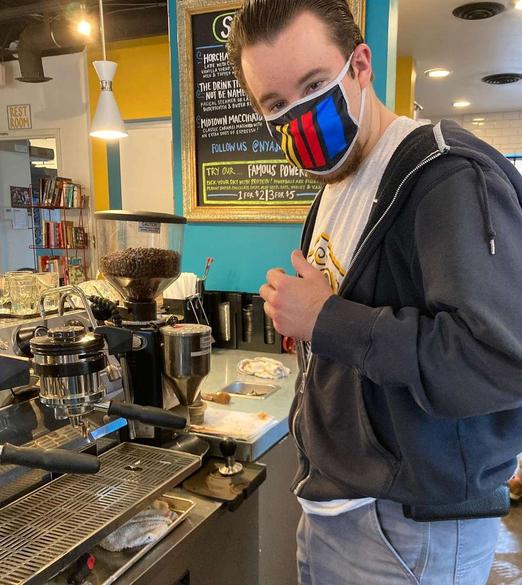 Brandon prepping coffee for the day